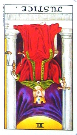 銀貨のカード:正義 - Justiceの逆位置